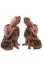 Siedzący tajski budda z głową w rękach - złoty efekt